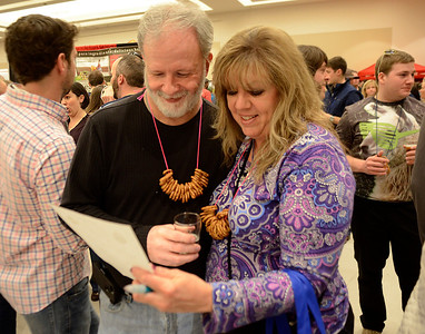 Ed Burke - The Saratogian02/22/14 Walt Shepardson and Lori Craig of Amsterdam look at selections as they check off boxes while playing Brewfest Bingo to try and win a sweatshirt during Saturday's Saratoga Beer Summit at the city center.