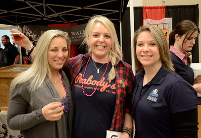 Ed Burke - The Saratogian02/22/14 The bar staff from Peabody's ejoy themselves during Saturday's Saratoga Beer Summit at the city center. From left: Alex Potter, Crystal Wood and Laura Nicolella.