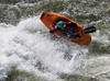 """Paddler Mike Leeds with an """"Air-Blunt"""" at the Trimax Wave in Idaho. Photo taken by Micah Kneidl"""
