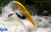 Paddler Mike Leeds. Air Looping a Creek Boat at Climax Surf Wave. Photo Grant Amaral