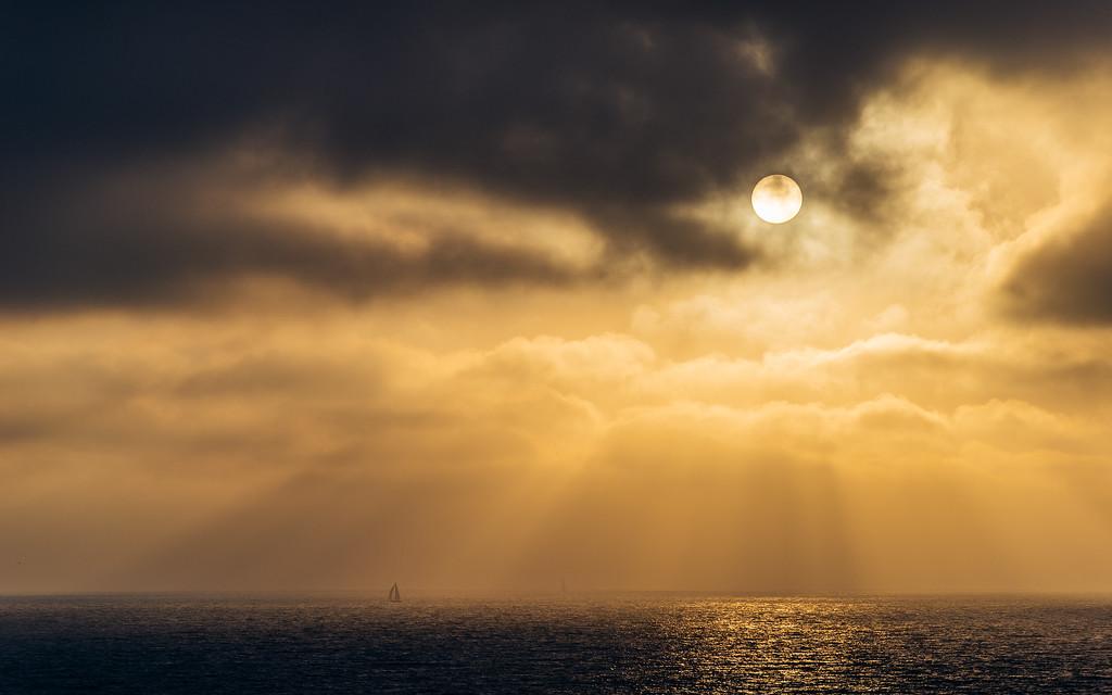 Sailboats and sun rays in Santa Monica Bay near Los Angeles.