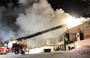 Firemen work from the back of the Friendship Farm Market and Restaurant in Amity Township on Old Swede Road Sunday evening pouring water on the blazing building. The building was gutted by fire.  Photo by John Strickler/The Mercury