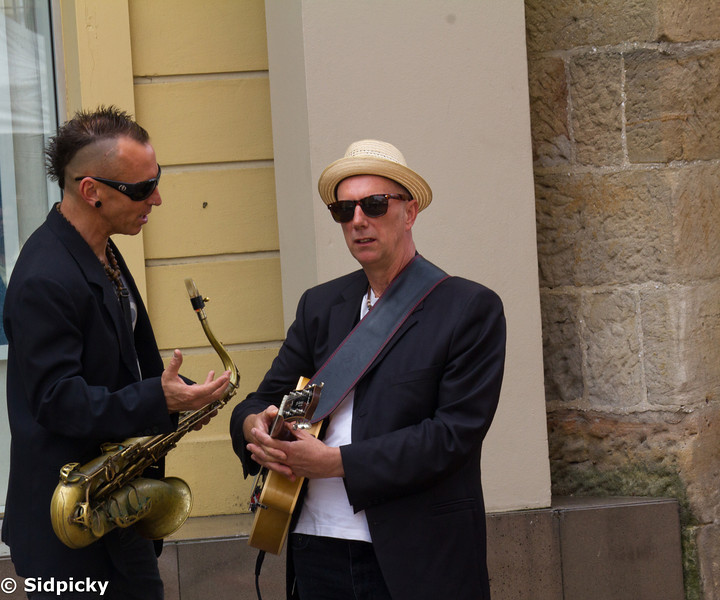 Titled 'Pre composition', this photo captures the mood of two of the kingdom's musicians discussing the finer points of their next rendition. Love the shades mate!!