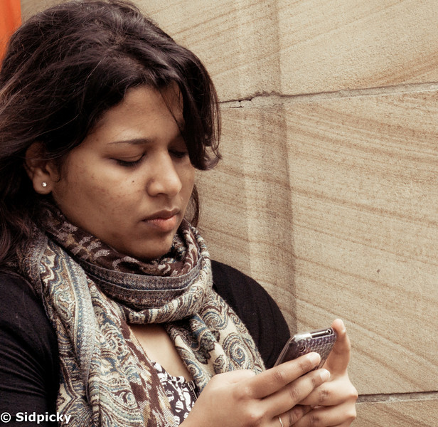 Princess Soumya interacting with a mobile device or maybe just checking if its time to call it a day.