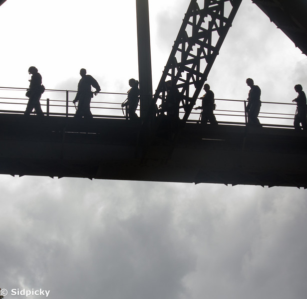 Watching the fearless adventure seekers of the land climb the famous harbour bridge. Yes, the royalty was right there to make fun of the poor souls.