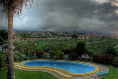 Pool with stormy clouds