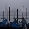 Gondolas on a foggy day, Venetian gondolas on a foggy day in front of San Giorgio Maggiore church on Canale Grande, St Mark Square, Venice, Veneto, Italy; © Joerg Muehlbacher