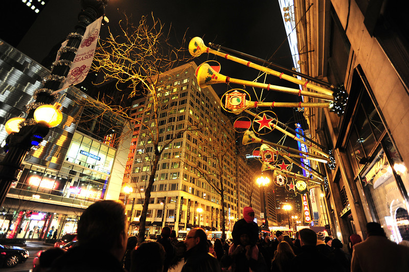 Trumpets, stars and dreidels on display in front of Macy's in downtown Chicago.