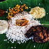 Karimeen, Delicious sweetwater fish served with red rice in a traditional way on banana leaf, Kumarakom, Kottayam, Kerala, India; © Joerg Muehlbacher