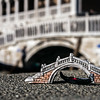 Miniature Gondola and Bridge, Picture of a miniature gondola and bridge from a souvenir shop taken in front of a real gondola passing a bridge in venice as background, Riva degli Schiavoni, Venice, Veneto, Italy; © Joerg Muehlbacher