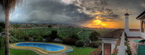Pool with stormy sunset