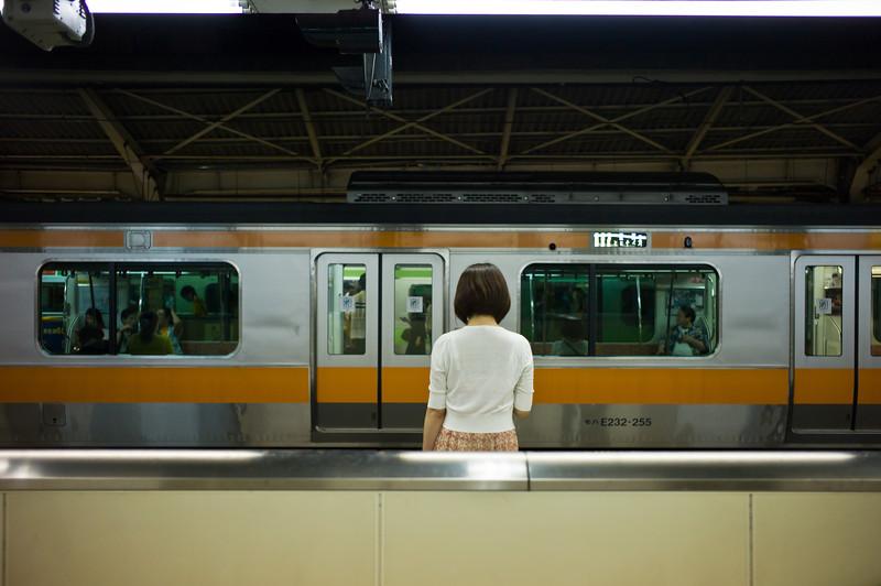 Girl waiting for train. Shinjuku.
