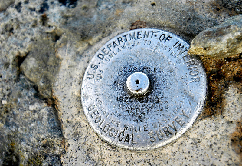 The geographical marker at the very peak of Mount Washington.