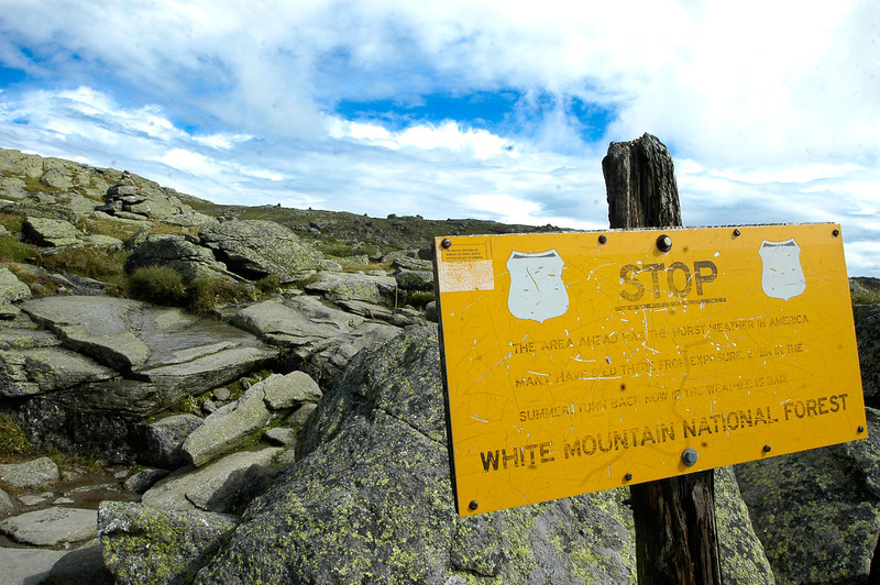 "This sign warns hikers of the rough conditions on the route up to Mount Washington. It reads: ""The area ahead has the worst weather in America. Many have died there from exposure even in the summer. Turn back now if the weather is bad."""
