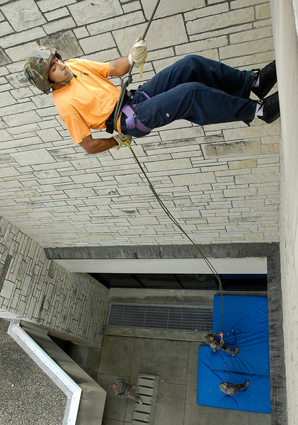Phillip Martinez, a University of Toledo student in the ROTC program, rappels down the side of the Student Union Building in September 2007. Several ROTC students rappelled down the building as a training exercise.