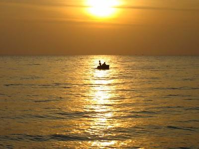 kids rowing a basket boat #2