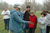Closeup of Bill talking to Seven Hills School students about planting native grass.