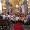 Pilgrims pose for a group photo in the sanctuary.