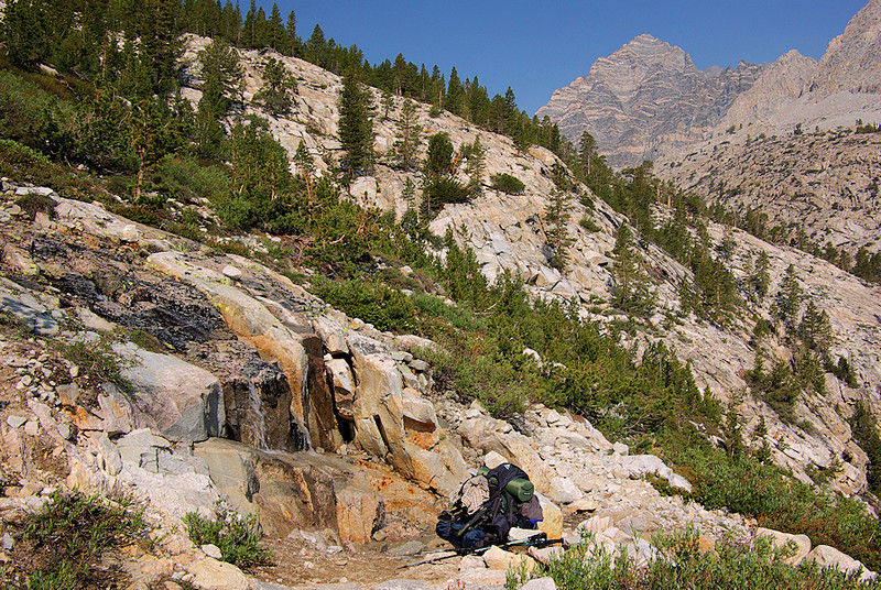 A view of my backpacking gear set against the landscape during my streamside rest stop. My backpack is a Gregory Baltoro that I will find is very comfortable considering all the gear I put on, and in, it.
