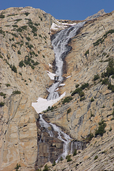 As I walk along the trail down French Canyon, I hear a distant roar from the right and see this beautiful cascade running gossamer-like down the mountainside. It's the outlet coming from the lakes below Merriam and Royce Peaks.