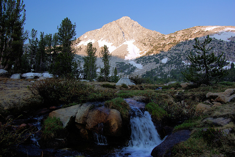 The Pine Creek Pass trail was originally a Mono Indian trading route and has been in use for nearly 500 hundred years. The path weaves through small subalpine meadows and rushing creeks. Royce Peak is the first to get the morning sun...
