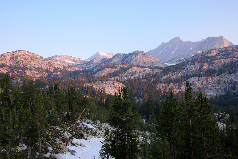 After a quick breakfast of coffee, oatmeal and Pop Tarts I head up the Pine Creek Pass trail. As I climb I look back for a view of Bear Creek Spire and Mt Julius Caesar, all bathed in early-morning light. There's still snow blocking, and occasionally obscuring, the path, but the routefinding is easy.
