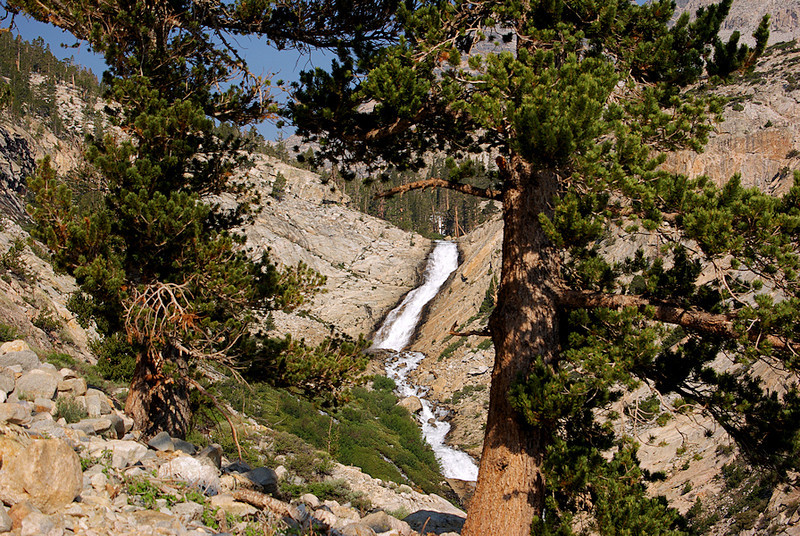The roar and cascades of Pine Creek are refreshing sounds and views accompanying the climber to the top...