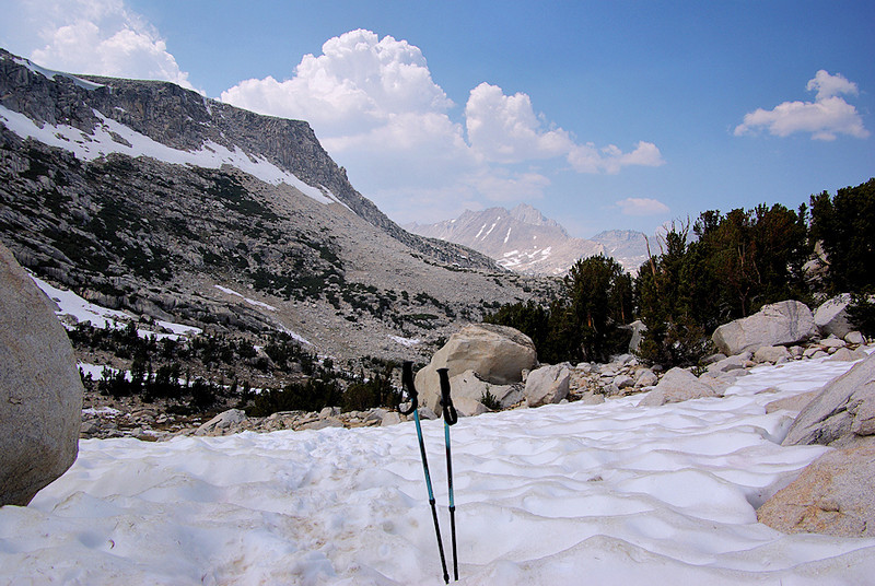 Here's one of the many snowfields still on the trail. The going was a little slippery in the morning; now you just go ankle-deep, if not find you're walking on top of a creek...I've had these REI adjustable treking poles for over 10 years, and they've saved my knees from a lot of stress and wear, particularly when going downhill.