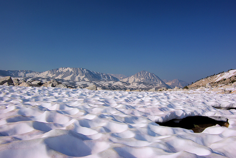 The snowfield creates an almost lunar landscape.
