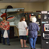 """The Mayo Woman's Club Pioneer Day Art Show inside the lobby of Lafayette State Bank. The theme this year was """"Reminiscing from your front porch."""" Pioneer Day Parade"""