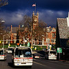 Four PVTA buses converge in front of the Academy of Music in Northampton.