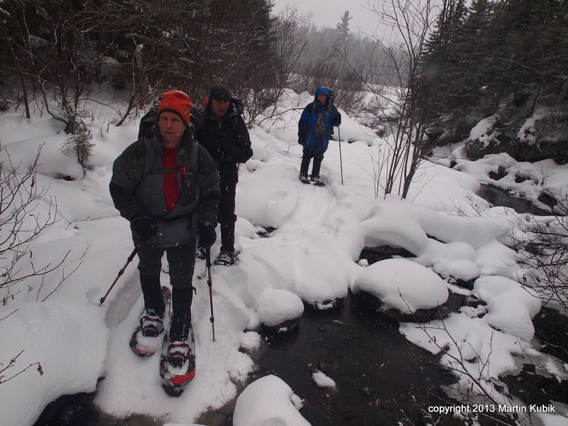 Choice;  Steep hill side or dance on the rocks.  Here is why I switched to metal snowshoes for this trip.