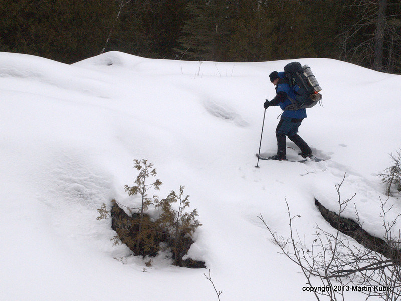 Brian ascends the 20 foot falls.   Claws on metal snowshoes and skipoles come in handy.