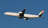 Here's a couple of pictures of a South African Airways Airbus A340 headed to Johannesburg.