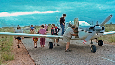Floodbound Sunday at Capella so CHAT plane will fly Barbara, Craig and Keith to Emerald for school on Monday. Burning tyres used for wind indicator. Brian & Paul camped in Diahatsu canopy. Saw ET movie at ond Capella canvas seat theatre.