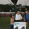 """Linda & Lon Holloway of Northwest Propane join Propane Exceptional Energy Hot Air Balloon Pilot, Philip Bryant for evening glow in Plano, """"Ballooning Capitol of Texas"""" for the 31st Annual Plano Balloon Festival."""