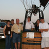 Sherry & Jeff Neal of Northwest Propane; Larry Baty of Cadenhead Servis Gas; Pilot, Philip Bryant; and Michael Terry of Linscot Enterprises help with the Sunday morning balloon tether at Oak Point Park at the Plano Balloon Festival.
