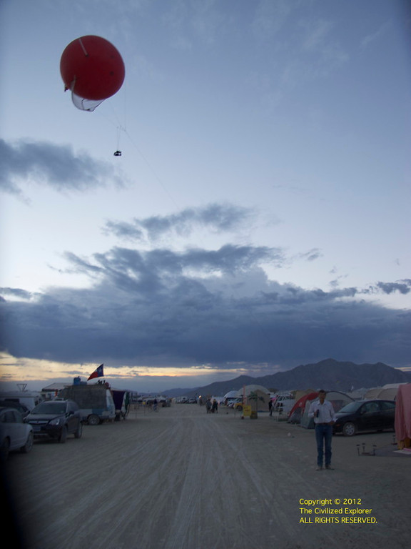Jack is our neighbor at Hushville, and he takes his balloon out for high-end views of the playa -- you can see the camera suspended below the balloon. Prevailing winds make it a chore to drag it back home.