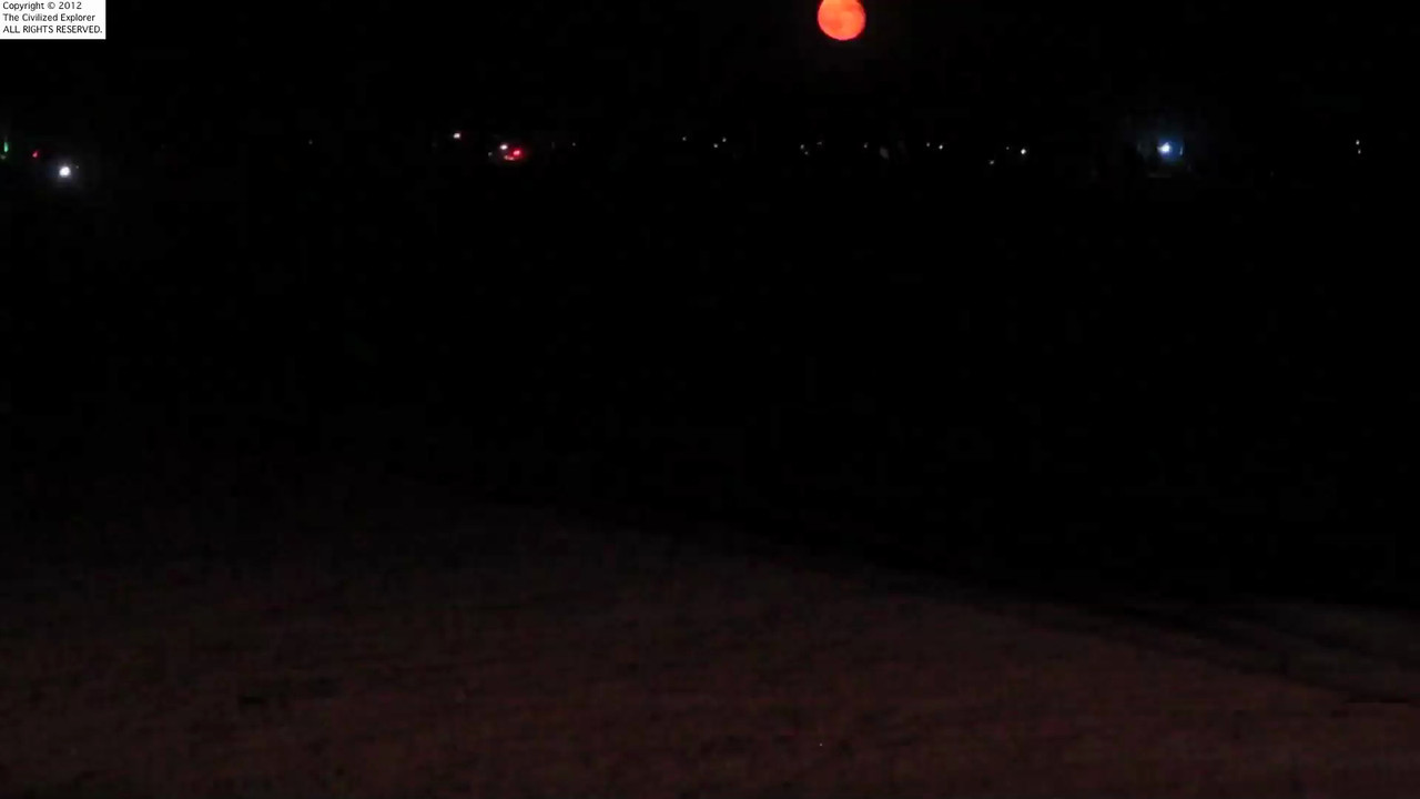 The red moon over some of the art on the playa.