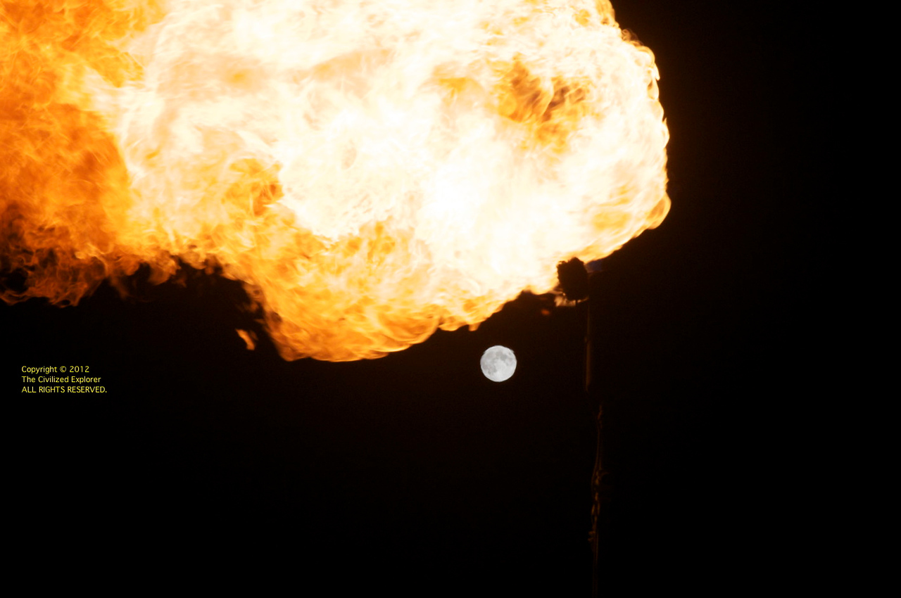 A flame and the moon. We had a great full moon on the playa this year.