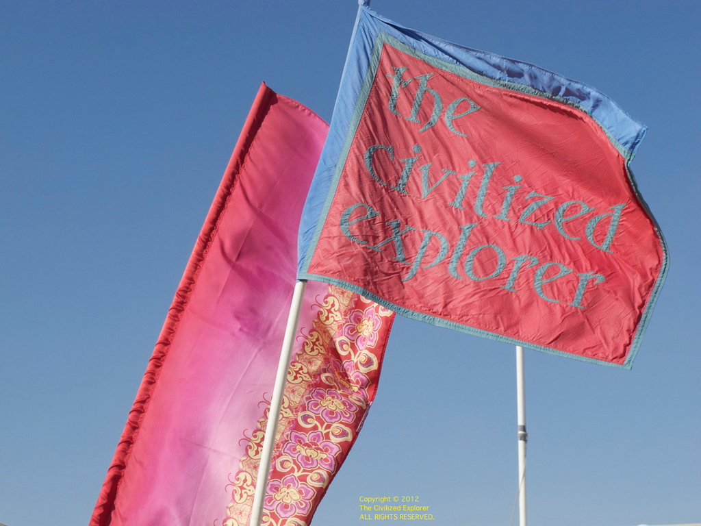 A view of our Civilized Explorer flag and one of the banners we put in front of our shade.