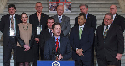 C.J. O'Donnell, Chief Marketing Officer, Hulman Sports speaking at a press conference in the PA Capitol Rotunda on March 10, 2014. Standing Left to Right - Marcus Jadotte, VP of Public Affairs and Multicultural Development, NASCAR; Rep. Mike Carroll; Sen. Lisa Baker; Rep. Sid Kavulich; Brandon Igdalsky, President & CEO of Pocono Raceway; Rep. Mario Scavello; Rep. Jerry Stern; Rep. John Payne; Sen. Tim Sollobay; and Rep. Doyle Heffley