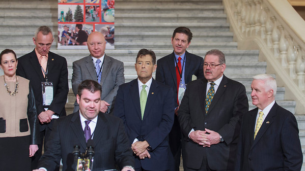 Brandon Igdalsky, President & CEO of Pocono Raceway speaking at a press conference in the PA Capitol Rotunda on March 10, 2014.  Standing Left to Right - Sen. Lisa Baker; Rep. Sid Kavulich; Rep. Mario Scavello; Rep. Jerry Stern; C.J. O'Donnell, Chief Marketing Officer, Hulman Sports; Sen. Tim Sollobay; and Governor Tom Corbett