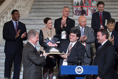 Brandon Igdalsky (Right), President & CEO of Pocono Raceway presenting a trophy to Senator David Argall and Representative Mike Carroll at a press conference in the PA Capitol Rotunda on March 10, 2014.  Standing Left to Right - Marcus Jadotte, VP Public Affairs NASCAR; Sen. Lisa Baker; Rep. Sid Kavulich; Rep. Mario Scavello; C.J. O'Donnell, Chief Marketing Officer, Hulman Sports and Rep. Jerry Stern