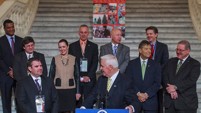 Governor Tom Corbett speaking at a press conference in the PA Capitol Rotunda on March 10, 2014. Standing Left to Right - Marcus Jadotte, VP Public Affairs NASCAR; Rep. Mike Carroll, Brandon Igdalsky, President & CEO of Pocono Raceway; Sen. Lisa Baker; Rep. Sid Kavulich; Rep. Mario Scavello; Rep. Jerry Stern; C.J. O'Donnell, Chief Marketing Officer, Hulman Sports; and Sen. Tim Sollobay