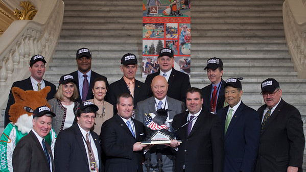 "Pocono Raceway Press Conference in the PA Capitol Rotunda on March 10, 2014. Standing Left to Right - Rep. Mike Peifer; Pocono Raceway Mascot, ""Tricky""; Sen. David Argall; Rep. Rosemary Brown; Marcus Jadotte, VP Public Affairs NASCAR; Rep. Mike Carroll, Sen. Lisa Baker; Nick Igdalsky, Executive Vice President & COO of Pocono Raceway; Rep. Sid Kavulich; Rep. Mario Scavello; Rep. Doyle Heffley; Brandon Igdalsky, President & CEO of Pocono Raceway C.J. O'Donnell, Chief Marketing Officer, Hulman Sports; Rep. Jerry Stern; and Sen. Tim Sollobay"