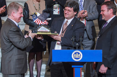 Brandon Igdalsky (Right), President & CEO of Pocono Raceway presenting a trophy to Senator David Argall and Representative Mike Carroll at a press conference in the PA Capitol Rotunda on March 10, 2014.
