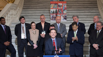 C.J. O'Donnell, Chief Marketing Officer, Hulman Sports speaking at a press conference in the PA Capitol Rotunda on March 10, 2014. Standing Left to Right - Marcus Jadotte, VP of Public Affairs and Multicultural Development, NASCAR; Rep. Mike Carroll; Sen. Lisa Baker; Rep. Sid Kavulich; Brandon Igdalsky, President & CEO of Pocono Raceway; Rep. Mario Scavello; Rep. Jerry Stern; Rep. John Payne; Rep. Doyle Heffley; and Sen. Tim Sollobay