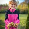 Grazyna with Maslaki Mushrooms in her yard
