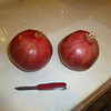 I like a small knife.  My Swiss Army knife is good because it has a small blade and the handle fits my hand.  Here are two pomegranates from the tree in my back yard.  Notice, the blossom-end is visible, stem end is down.
